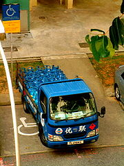 Truck carrying LPG cylinders to residential consumers in Singapore