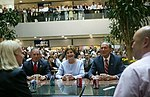 Laura Bush, Michael Bloomberg, and George Pataki meet with employees at Citigroup.jpg