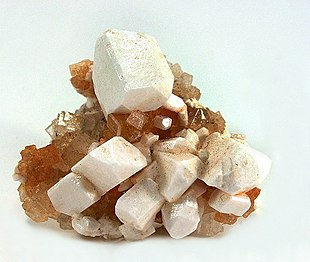 leonite as white pseudomorphs after sharp freestanding picromerite crystals sizes to 2 cm, perched on a matrix of crystallized halite. 5.5 x 4.7 x 3.4 cm