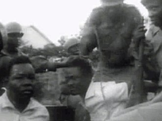 Dissolution of the Lumumba Government - Lumumba (center), detained by Mobutu's soldiers, before transport to Thysville