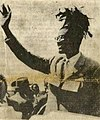 Lumumba waves to supporters.jpg
