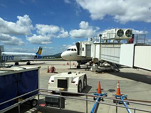 Asheville Regional Airport - An Allegiant Air MD-83 and Delta Air Lines Airbus A319 parked at the gate