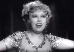 I'm No Angel - Screenshot of Mae West performing her burlesque dance in front of men