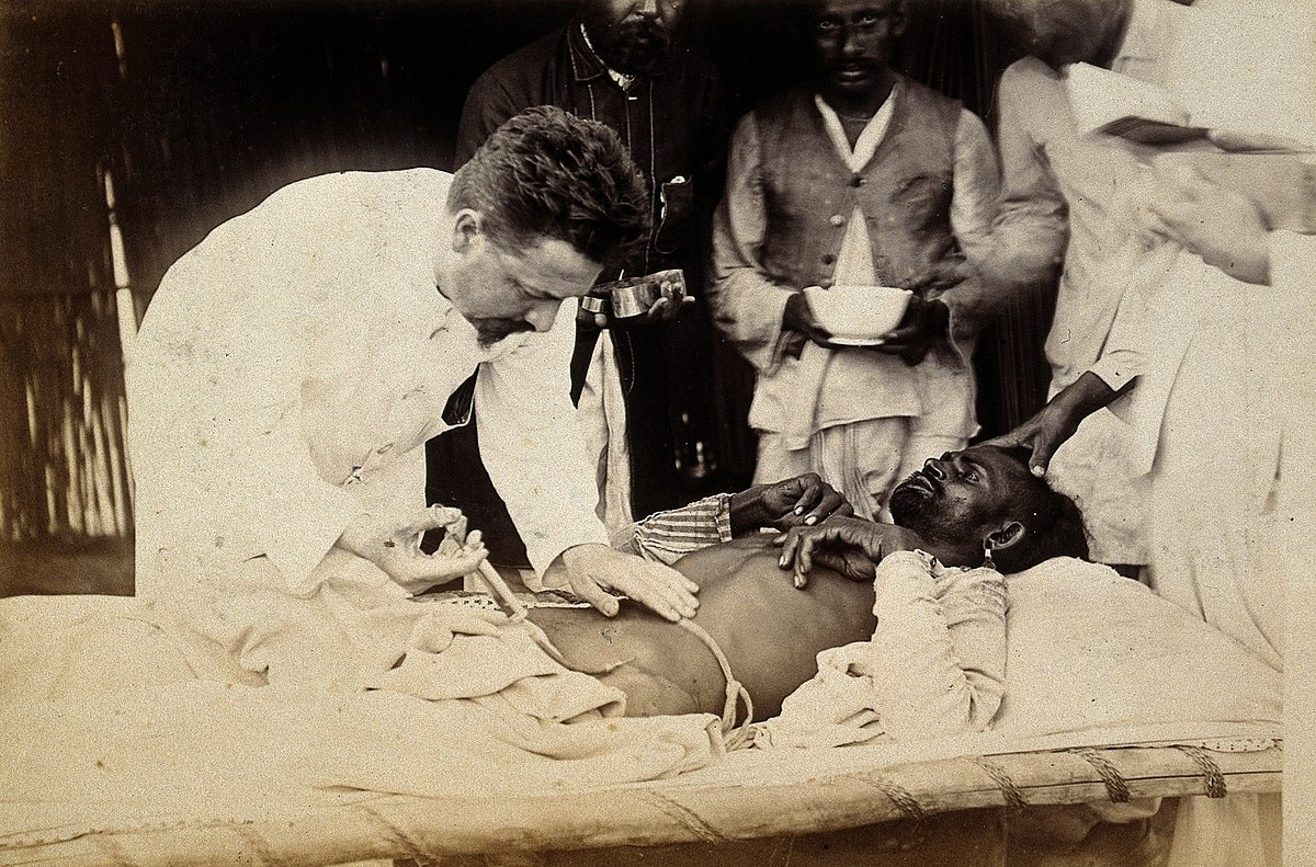 Man being injected by doctor, during the outbreak of bubonic Wellcome V0029287.jpg