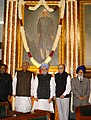 Manmohan Singh paid floral tributes at the portrait of the first President of India, Late Dr. Rajendra Prasad, on the occasion of his 123rd birth anniversary, at Central Hall, Parliament House in New Delhi.jpg