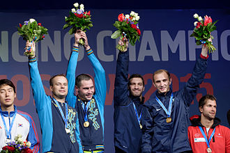 Bohdan Nikishyn - Nikishyn (2nd to left) and teammates celebrate their gold medal in the 2015 World Fencing Championships