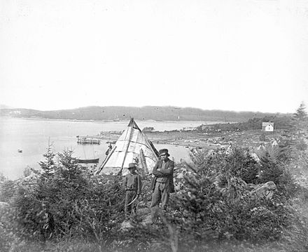 Mi'kmaq family in Tuft's Cove, 1871. The Mi'kmaq inhabited Nova Scotia when the first Europeans arrived. Mi'kmaq people at Tufts Cove, Nova Scotia, Canada, ca. 1871.jpg