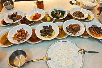 Padang cuisine - The hidang style Padang food served at Sederhana restaurant; all of the bowls of food are laid out in front of customer. The customer only pays for whatever bowl they eat from.