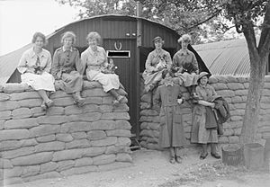 Timeline of Rouen - Members of Queen Mary's Army Auxiliary Corps outside their Nissen hut billets in Rouen, on 18 June 1918
