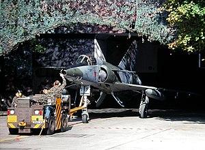 Mirage 2115 exits cavern Buochs