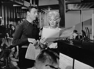 Yves Montand and Monroe in the musical comedy Let's Make Love (1960), which she agreed to make only to fulfill her contract with Fox Monroe Montand Let's Make Love.jpg