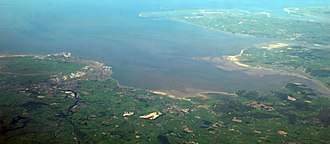 Morecambe Bay - A panorama of most of Morecambe Bay looking from East (bottom of photo) to West (top of photo). Barrow-in-Furness and Walney Island can be seen in the upper part of the photo and Lancaster and Morecambe are visible in the lower left-hand corner of the photo.