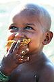 Mumbai baby eating.jpg