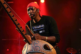 N'Faly Kouyate - Kouyate playing the kora with the Afro Celt Sound System, August 2007
