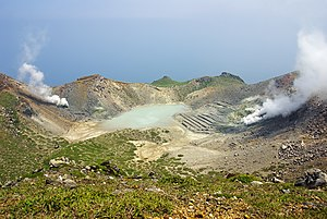 Tokara Islands - The crater on the highest peak (Otake) in Nakano-shima. The stripes that can be seen at the right in this photograph are disused sulfur mining facilities.