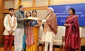 Narendra Modi presenting the National Bravery Awards 2015 to the children, in New Delhi on January 24, 2016. The Union Minister for Women and Child Development, Smt. Maneka Sanjay Gandhi is also seen (17).jpg