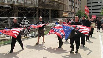 Modern display of the Confederate battle flag - Members of the Detroit-based National Socialist Movement marching at Market Square in Knoxville, Tennessee - 14 August 2010