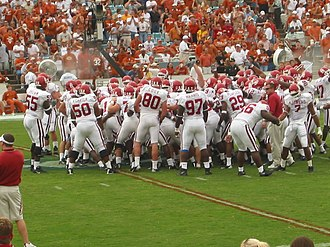Oklahoma Sooners - The Oklahoma squad in a pregame huddle.