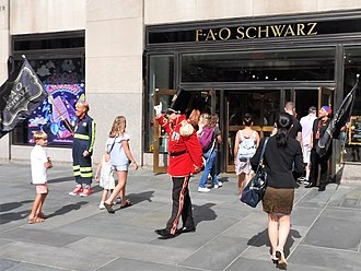 FAO Schwarz door opening ceremony at 30 Rockefeller Plaza Officer of the Day opens FAO Schwarz jeh.jpg