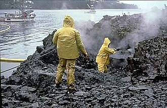 Exxon Valdez oil spill - Workers using high-pressure, hot-water washing to clean an oiled shoreline