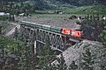 Okanagan Express CP 8836 and 8839 on Trout Creek Bridge at West Summerland, BC on May 23, 1983 (34809975713).jpg