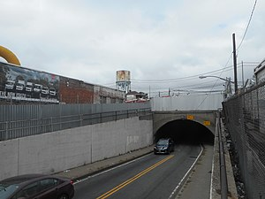 Dunton (LIRR station) - The 130th Street Tunnel with the Dunton Tower in the background, the approximate site of the former Dunton LIRR station in September 2017.