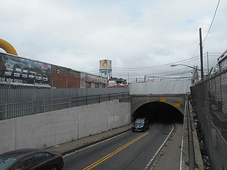 Dunton station - The 130th Street Tunnel (with a Kew Gardens water tank in the background). This is the approximate site of the former Dunton LIRR station in September 2017.
