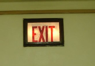 Exit sign - Dim early exit signs lit by incandescent bulbs