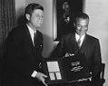 Olympio presents gift to Kennedy.jpg