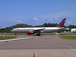 Omni Air International - An Omni Air Boeing 777-200ER arrives at Bermuda International Airport