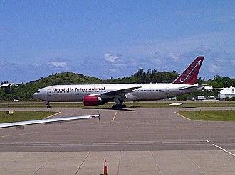 Omni Air International - An Omni Air Boeing 777-200ER arrives at Bermuda International Airport