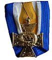 Onderscheidingsteken voor Eervolle Langdurige Dienst als Officier witte achtergrond.jpg