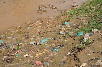 Open defecation - Open defecation along a river bank in Bujumbura, Burundi