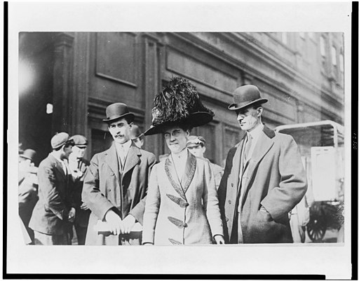 Orville Wright, William Wright, and Katharine Wright, half-length portraits, standing outdoors LCCN95507539
