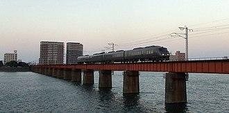 Nippō Main Line - Kirishima limited express train crossing Ōyodo River, Miyazaki