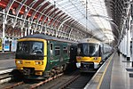 Paddington - GWR 165102 and Heathrow Express 332007.JPG