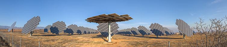 Panoramic view of the photovoltaic power station of Cariñena, Zaragoza, Spain. The panels are mounted on dual axis trackers in order to maximise the intensity of incoming direct radiation. This solution enables the arrays to track the sun in its daily orbit.