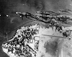 Pearl harbor Battleship row after the attack high level aerial view 80G387565.jpg