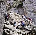People (and dog) climbing Gordale Scar - panoramio.jpg