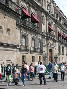 People walking Mexico City streets with mask due to swine flu.jpg