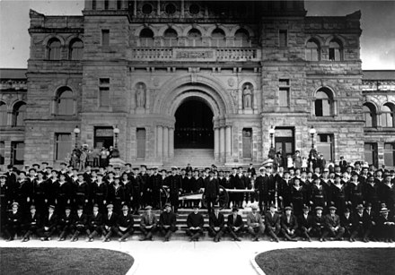 Royal Canadian Naval Volunteer Reserve members stand outside the provincial legislature in 1914. Personnel of the Royal Naval Canadian Volunteer Reserve outside the British Columbia Legislature.jpg