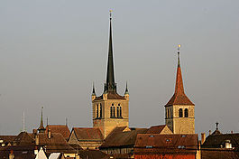 The towers of the Abbey and the Reformed church above Payerne