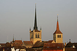 Payerne - The towers of the Abbey and the Reformed church above Payerne