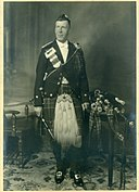 Pipe Major John Grant c. 1911 in full regalia.jpg