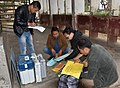 Polling officials checking the Electronic Voting Machines (EVMs) and other necessary inputs required for the Nagaland Assembly Election, at a distribution centre, in Dimapur on February 26, 2018.jpg