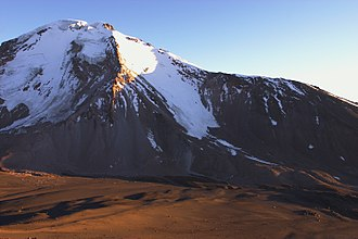 Pomerape - Pomerape and the saddle below, as seen from south (Parinacota slopes)