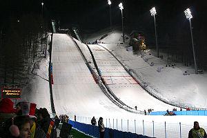 Venues of the 2006 Winter Olympics - Pragelato ski jump during the 2006 Winter Olympics. The venue hosted the ski jumping and the ski jumping portion of the Nordic combined events.