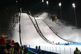 Venues of the 2006 Winter Olympics - Pragelato ski jump during the 2006 Winter Olympics. The venue hosted the ski jumping and the ski jumping portion of the Nordic combined events.