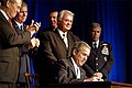 President George W. Bush signs a defense appropriations bill at the Pentagon.jpg
