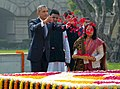 President Obama tosses petals on Mahatma Gandhi's tomb at Rajghat in New Delhi.jpg